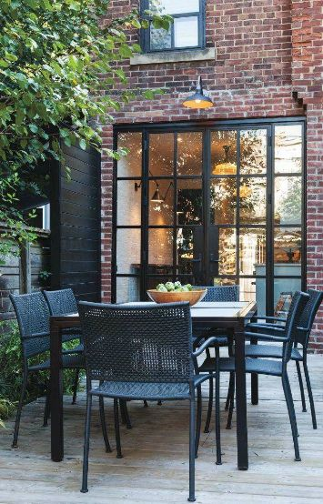 Back of small Toronto kitchen...Love the black trim on the windows.