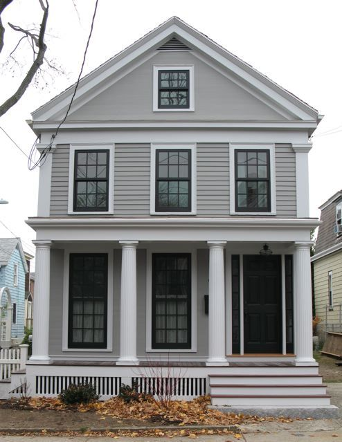 The house color is Benjamin Moore Graystone, the trim is Silver Chain. The door is plain Black which seemed to best match the Marvin windows which are aluminum clad.